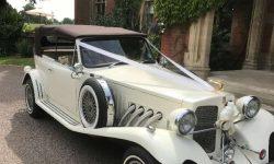 1930's style 2 door Beauford open-top convertible tourer in Ivory (roof up)