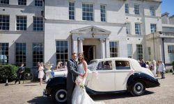 1952 Bentley 'R' Type Sports in Ivory with Black running boards and arches with Bride and Groom 2