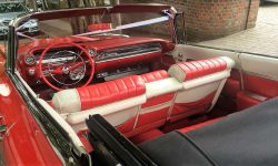 1959 Cadillac convertible in Festival Red interior