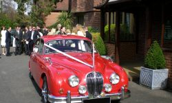 1964 Red MK II Jaguar with chrome wire-wheels 3