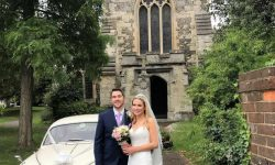 1961 Jaguar MK II in Old English White with Bride and Groom