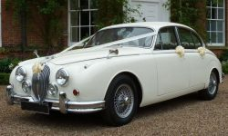 1961 MK II Jaguar in Old English White with dark Red leather interior and wire-wheels 5