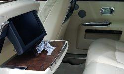Modern Rolls Royce Silver Ghost in White interior 1